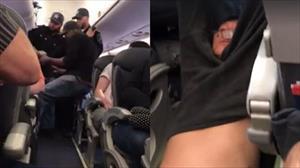 Hãng hàng không Mỹ bị chỉ trích vì lôi hành khách xuống máy bay
