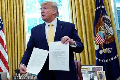 Ông Trump ký thoả thuận giai đoạn một với Trung Quốc